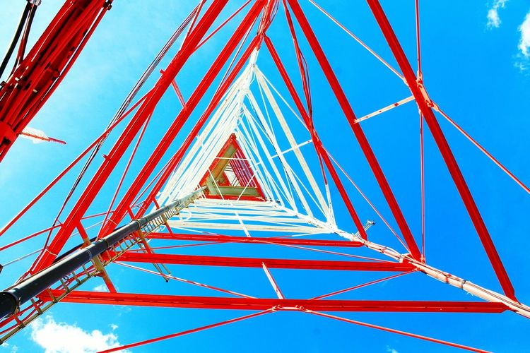Directly Below Shot Of Communication Tower Against Sky