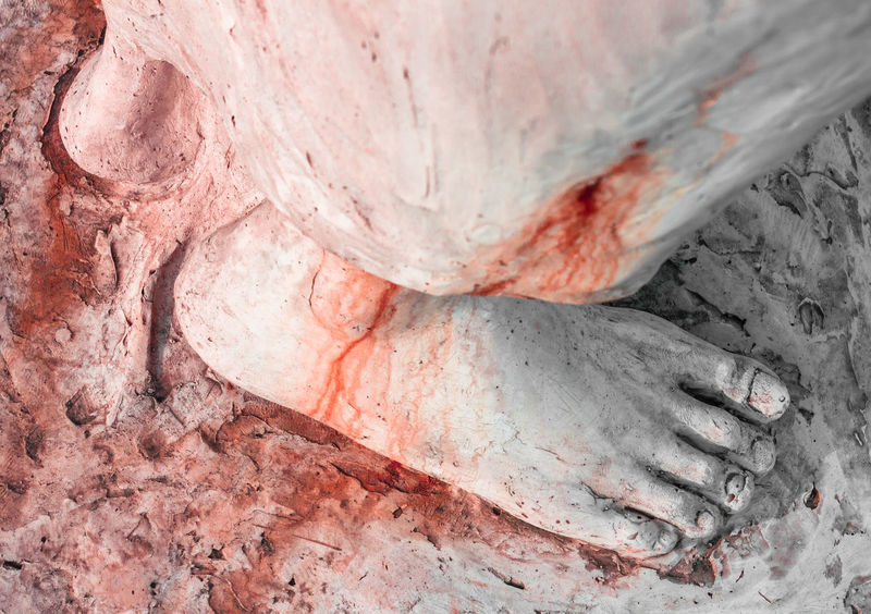 Extreme close-up of the feet of Jesus Christ bloodied. Top view. Art Bible Blood Calvary Catholic Christ Christian Christianity Death Detail Easter Faith Feet Foot God Holy Icon Isolated Jesus Love Nail Pain Passion Pray Prayer