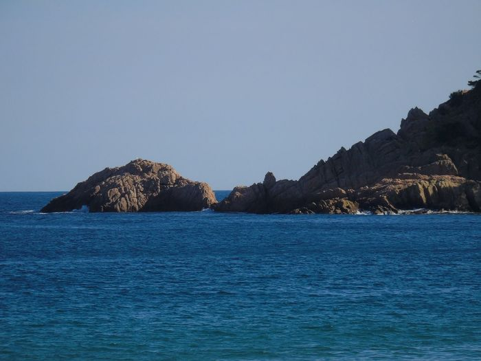 Costa Brava, Girona,Spain Costa Brava, Coast Costa Brava Spa Costa Brava Sea Water Rock Rock - Object Solid Scenics - Nature Sky Beauty In Nature Land Nature No People Beach Rock Formation Day Tranquility Waterfront Tranquil Scene Blue Outdoors Stack Rock