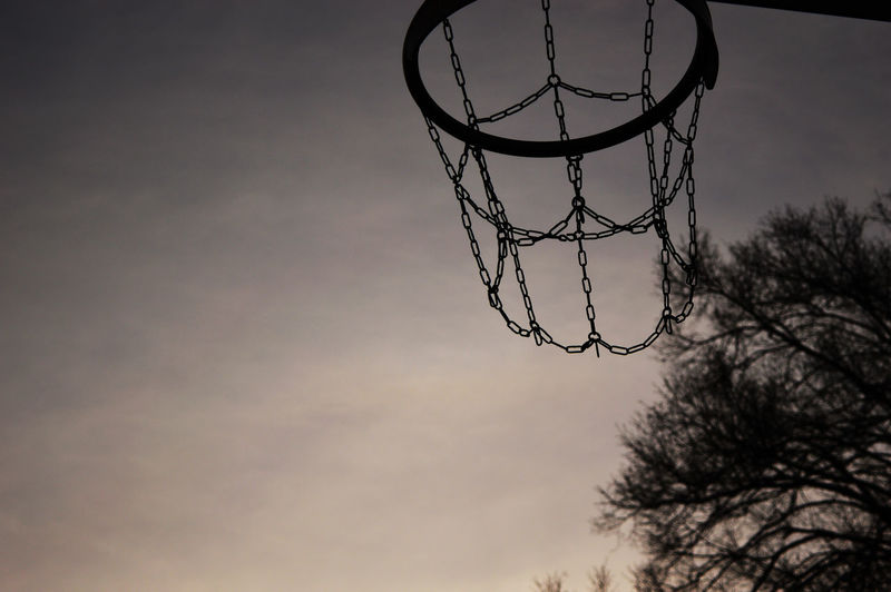 Low angle view of silhouette basketball hoop against sky during sunset