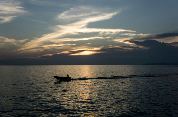 Home before light goes down Beauty In Nature Cloud - Sky Day Horizon Over Water Nature Nautical Vessel One Person Outdoors People Scenics Sea Silhouette Sky Sunset Tranquil Scene Tranquility Water Waterfront Mabul Island Malaysia Mabul Mabul Island Lost In The Landscape
