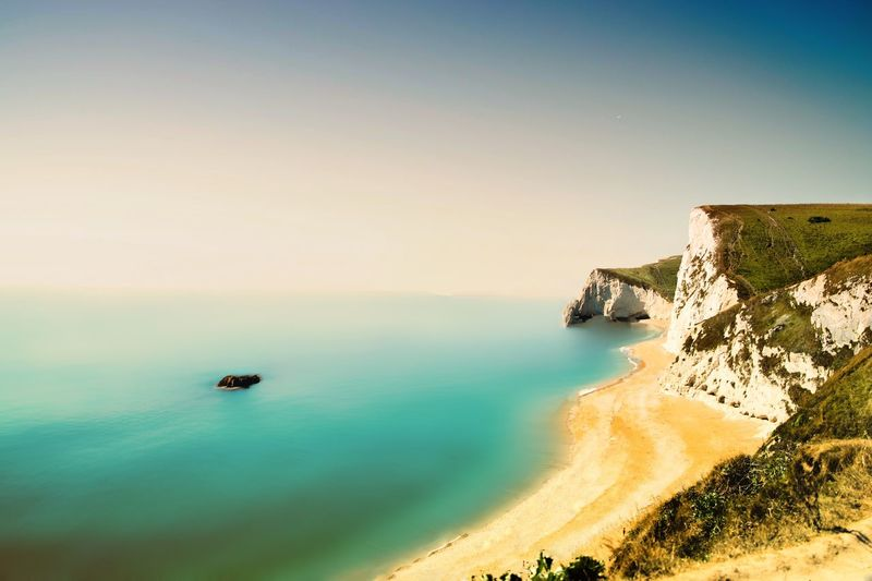 Sea Water Nature Scenics Beauty In Nature Tranquil Scene Rock - Object Tranquility High Angle View Outdoors No People Day Beach Sky Horizon Over Water Clear Sky Nautical Vessel Durdle Door Your Ticket To Europe Your Ticket To Europe Been There. Lost In The Landscape Colour Your Horizn Summer Exploratorium