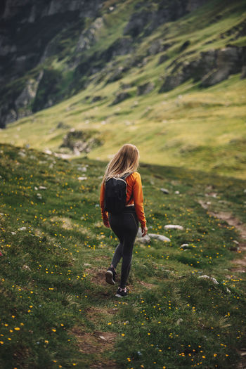 Woman backpacker walking on a pathway in the mountains. discovery,travel concept