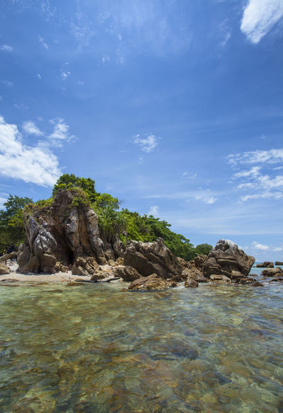 A Small Island with rock formation at the beach in the brightday with bluesky INDONESIA Beauty In Nature Blue Cloud - Sky Day Geology Nature No People Outdoors Rock Rock - Object Rock Formation Scenics Sea Sky Tranquil Scene Tranquility Tree Water