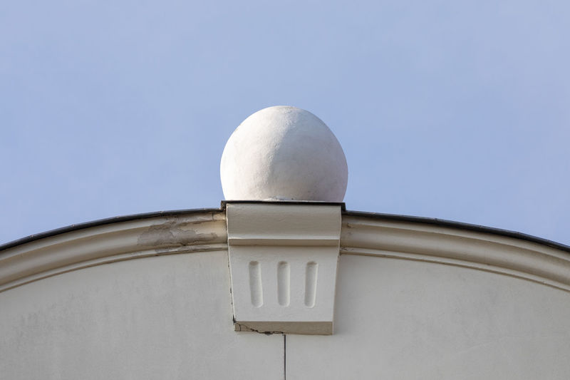 Close-up of concrete sphere on the roof of an old building Architectural Feature Architecture Art And Craft At The Edge Of Building Exterior Built Structure City Clear Sky Close-up Concrete Copy Space Day Decoration Geometric Shape Low Angle View Old Old-fashioned Outdoors Roof Simplicity Single Object Sky Sparse Sphere White Color