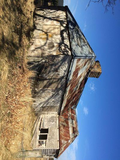 Blue Sky Rusty Roof Abandoned House