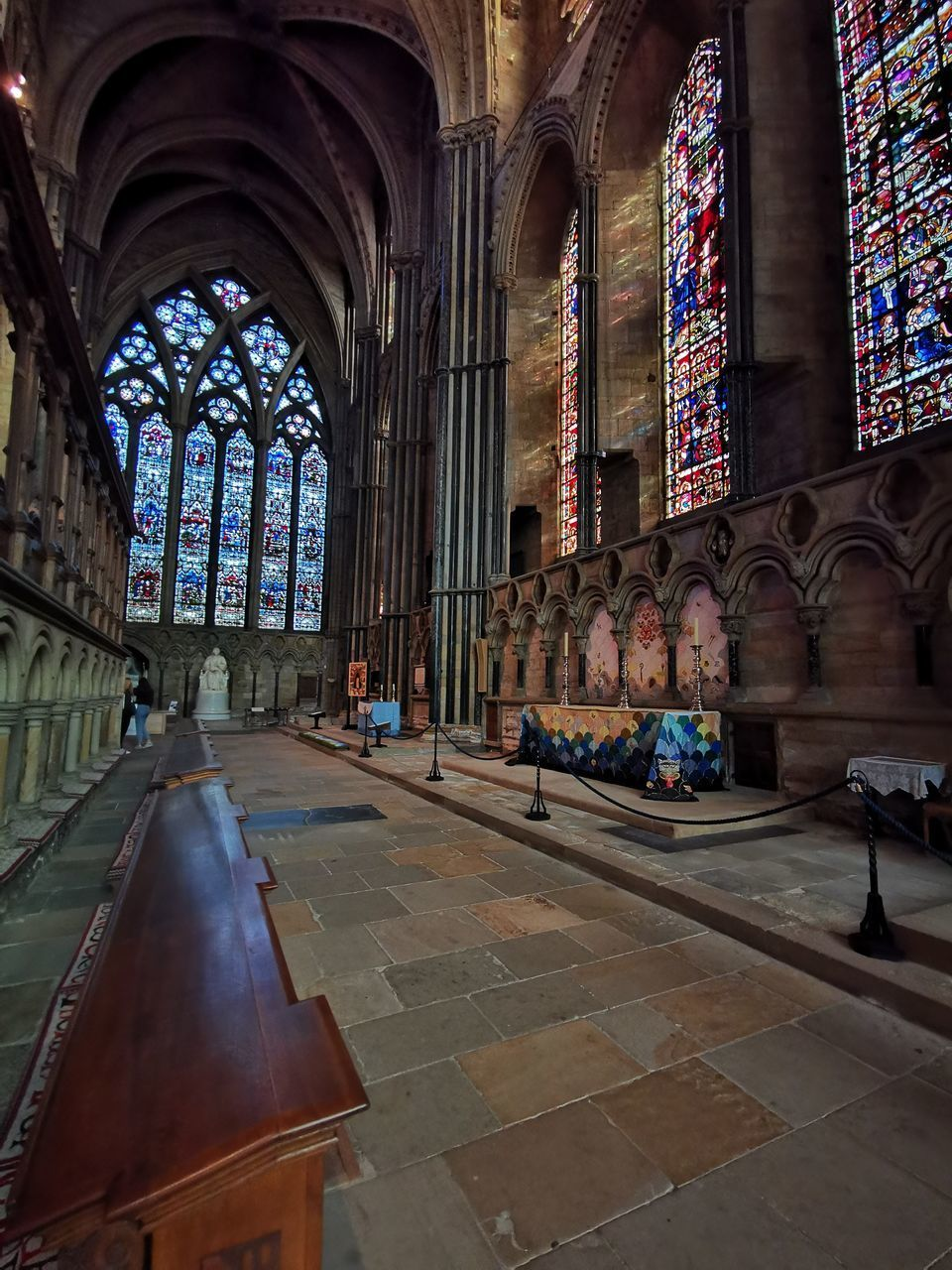 religion, spirituality, belief, place of worship, architecture, built structure, building, indoors, arch, pew, stained glass, day, glass, art and craft, window, architectural column, aisle, tiled floor, ornate