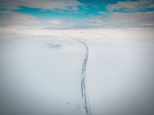 Snowy road Mountains Blue Sky Sun Snow Winter Wonderland Snowy Road Travelling Car Road Iceland Aerial View Drone  Mavic Air Landscape Sand Tranquility Nature Scenics Beauty In Nature Outdoors Day No People Cold Temperature Pastel Colored Go Higher Visual Creativity