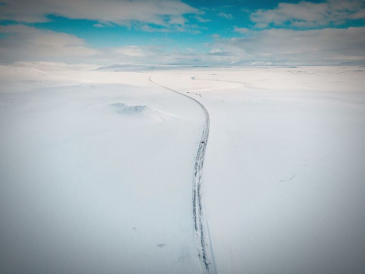 Snowy road Mountains Blue Sky Sun Snow Winter Wonderland Snowy Road Travelling Car Road Iceland Aerial View Drone  Mavic Air Landscape Sand Tranquility Nature Scenics Beauty In Nature Outdoors Day No People Cold Temperature Pastel Colored Go Higher