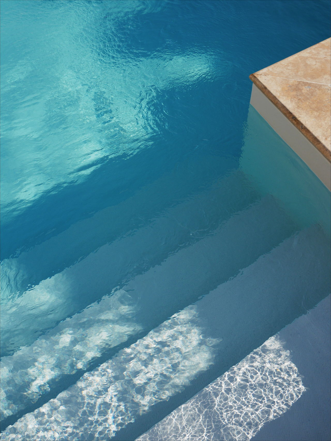 HIGH ANGLE VIEW OF SWIMMING POOL AT SEA