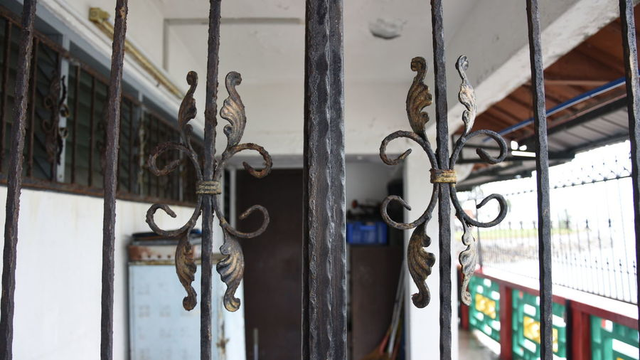 Close-up of old metal gate