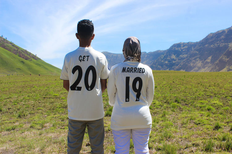 Get Married Get Married Adult Rear View Two People Women Grass Text Togetherness Men Nature Casual Clothing Young Adult People Couple - Relationship Sport Standing Females Beauty In Nature Communication Leisure Activity Plant