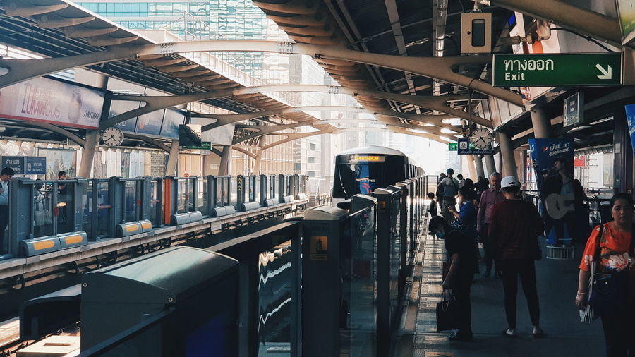 Public Transportation Transportation Real People Architecture Mode Of Transportation Group Of People Rail Transportation Travel Train Train - Vehicle Built Structure Railroad Station Men People City Lifestyles Railroad Station Platform Passenger Women Day Outdoors