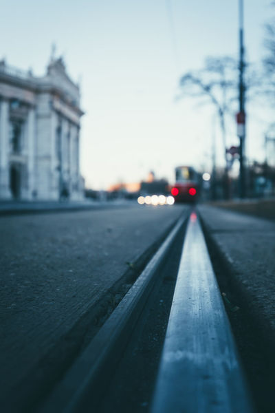 A Red tram is on the way to sunrise Austria City EyeEmNewHere Leading Lines Rails Tram Vienna Bokeh Bokeh Background Bokeh Lights Burgtheater No People Ringstrasse Street Tramway Transportation