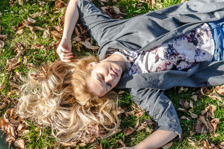 Casual Clothing Cute Day Field Grass Leisure Activity Lifestyles Lying Down Outdoors Park Portrait Relaxation