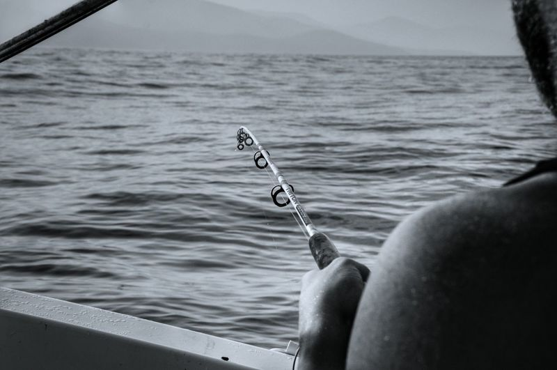 Fishing Time Blackandwhite Localscene Local People Local Culture Peaceful View People Of The Oceans From My Point Of View Fishing Boat Fisherman Majestic Moody Sea Tranquility Malephotographerofthemonth Capture The Moment Tranquil Scene Weekend Activities Relaxation Calm Water Boat Fishing Rod Blackandwhite Photography Monochrome Photograhy