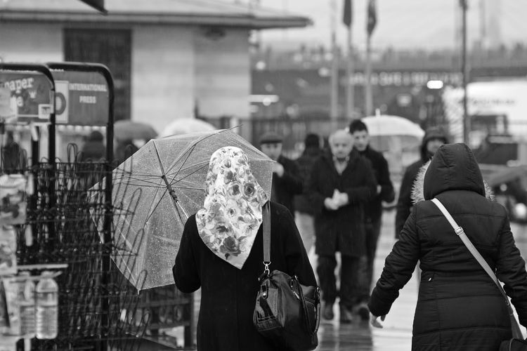 Black Blackandwhite EyeEm EyeEm Gallery Holiday Lifestyles Men Monochrome People People Photography Peoplephotography Rain Rainy Days Real People Rear View Showcase: February Standing Street Street Photography Streetphoto_bw Streetphotography Taking Photos Walking Weekend Women The Street Photographer - 2017 EyeEm Awards