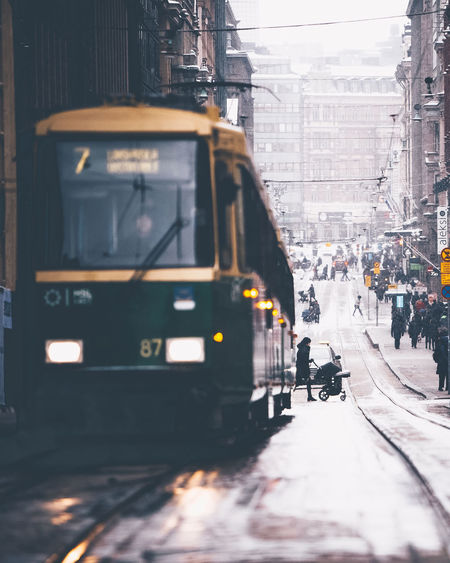 Train on city street during winter