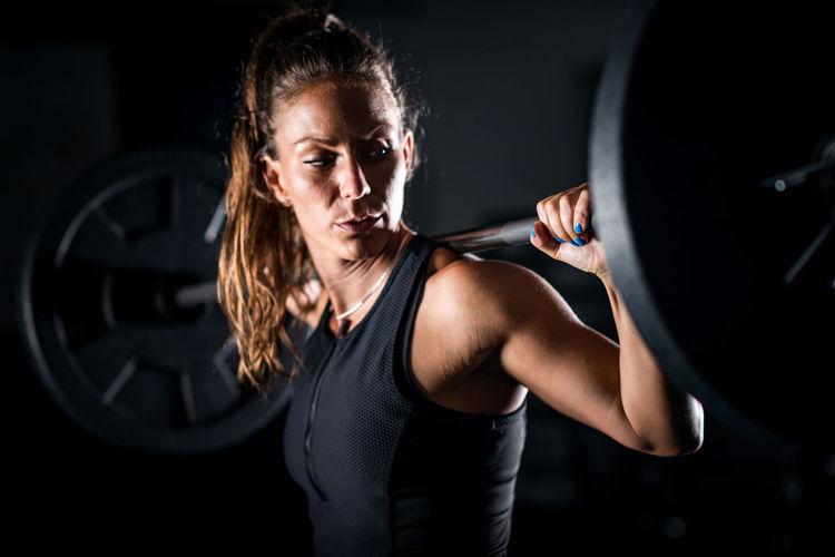 Athlete Weightlifting In Gym
