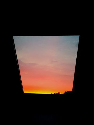 Sunset in a funny shape 💗 Sunset Window Sky Dramatic Sky Cloud - Sky Low Angle View Silhouette No People Built Structure Indoors  Architecture Nature Scenics Building Exterior Beauty In Nature Close-up Nearly Night Time Sunsets Of Eyeem Shape Of You Shape Of Nature A Piece Of Paradise A Piece Of Heaven