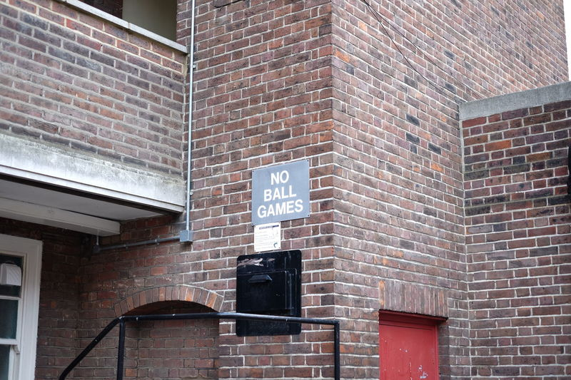 Architecture Brick Wall Building Exterior Built Structure Communication Day Information Sign Low Angle View No People Outdoors Road Sign Text