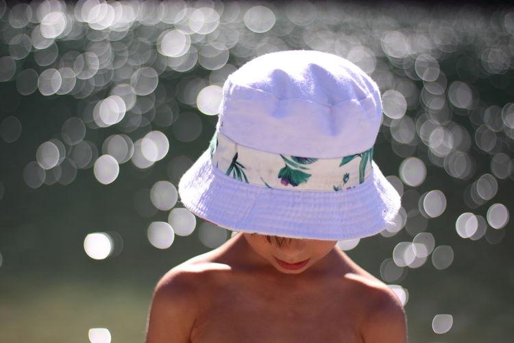 Portrait of shirtless boy wearing hat