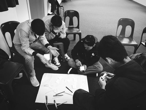 During a refugee youth meeting. (Durante una reunión de jóvenes refugiados.) Youth Refugees Black & White Meeting Teamwork Planning Cultures Juventud Refugiados Blanco Y Negro Reunion  Trabajo En Equipo Planificacion Culturas Welcome To Black Resist TCPM The Photojournalist - 2017 EyeEm Awards Live For The Story Place Of Heart Investing In Quality Of Life