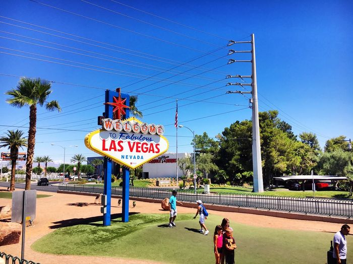 Vegas! Nevada Las Vegas Text Sky Western Script Communication Nature Sign Plant Tree Day Clear Sky Architecture Sunlight City Built Structure Water Sunny Information Blue Incidental People Outdoors EyeEmNewHere