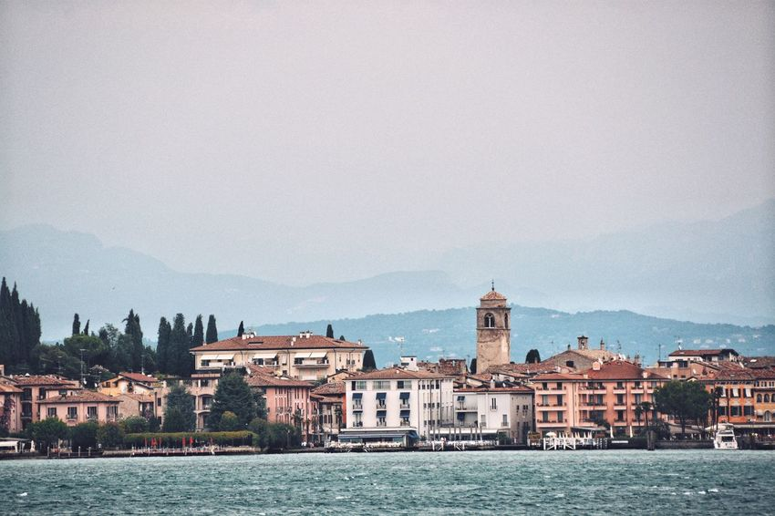 Beauty by three; water, land, and mountains. Tranquility Italy Urbanity Mountain Range Mountain Lake Town Port Building Exterior Architecture Building Built Structure Water City Sky Travel Destinations Residential District The Past Tower History Waterfront Town