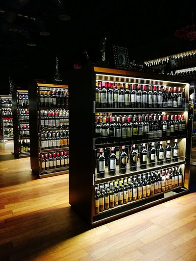 Wine Bottle Wine Alcohol Indoors  No People Wine Rack In A Row Lined Lined Up Lined Up In A Row Wine Racks Wine Bottles Wine Moments Wineandmore Wine Selection Illuminated Choices Wine Display Display Abundance Drinking Drinks Nightlife Night Out Wine Lounge Wine Moments