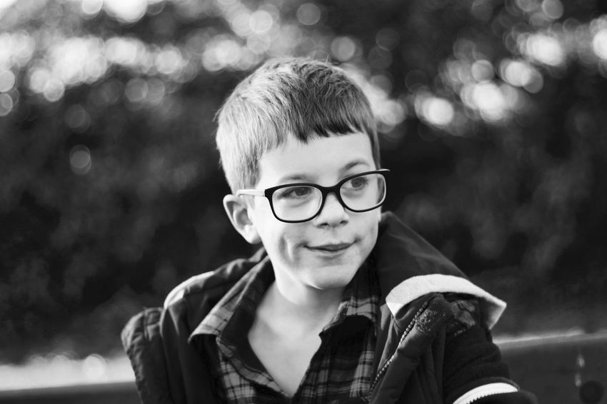 Black and white image of a boy with glasses. Children Kids Blackandwhite Boy Boys Child Childhood Close-up Contemplation Emotion Eyeglasses  Focus On Foreground Glasses Happiness Headshot Kid Looking At Camera Males  One Person Portrait Portraiture Smiling The Portraitist - 2018 EyeEm Awards