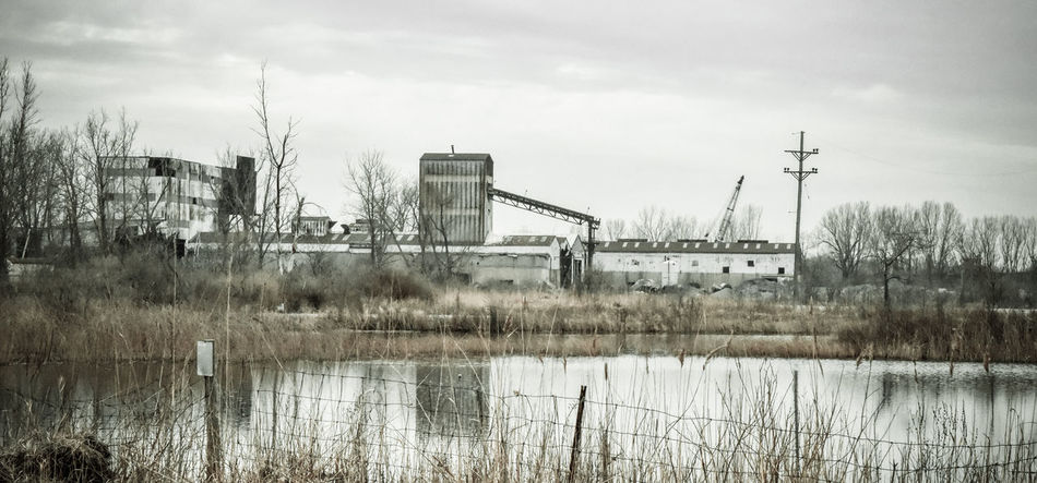 Urban Exploration abandoned buildings Abandoned Architecture Bradley Olson Bradleywarren Photography Building Exterior Built Structure Cloud Cloud - Sky Connection Day Electricity Pylon Factory Grass Lake Nature No People Plant Reflection River Sky Tranquil Scene Tranquility Tree Vintage Water