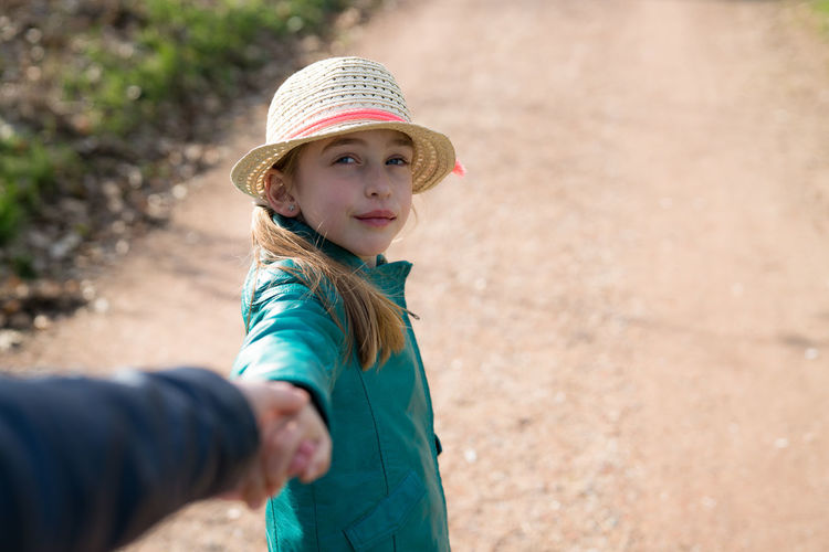 cute girl with hat walking outside holding hands Beautiful Casual Clothing Child Childhood Children Only Cute Day Family Fun Girl Happiness Hat Holding Hands Lifestyles Love One Girl Only One Person Outdoors People Portrait Walking This Is Natural Beauty