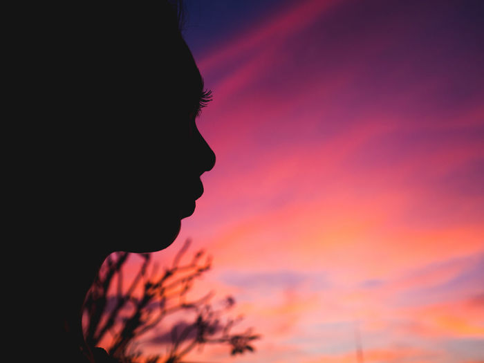 Her silhouette. Close-up Sunset Headshot Silhouette Woman Sky Colorful Face Beautiful