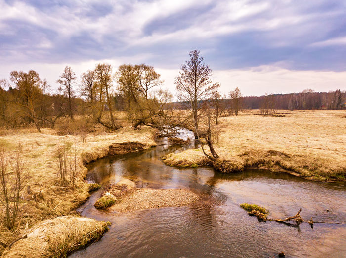 Sky Water Tree Cloud - Sky Tranquility Beauty In Nature Plant Scenics - Nature Tranquil Scene Nature Non-urban Scene No People Land Environment Landscape Day Rock Bare Tree Outdoors Flowing Water Flowing Spring Springtime April River Belarus Belarus Nature Brook Stream Creek Riverbank Sula
