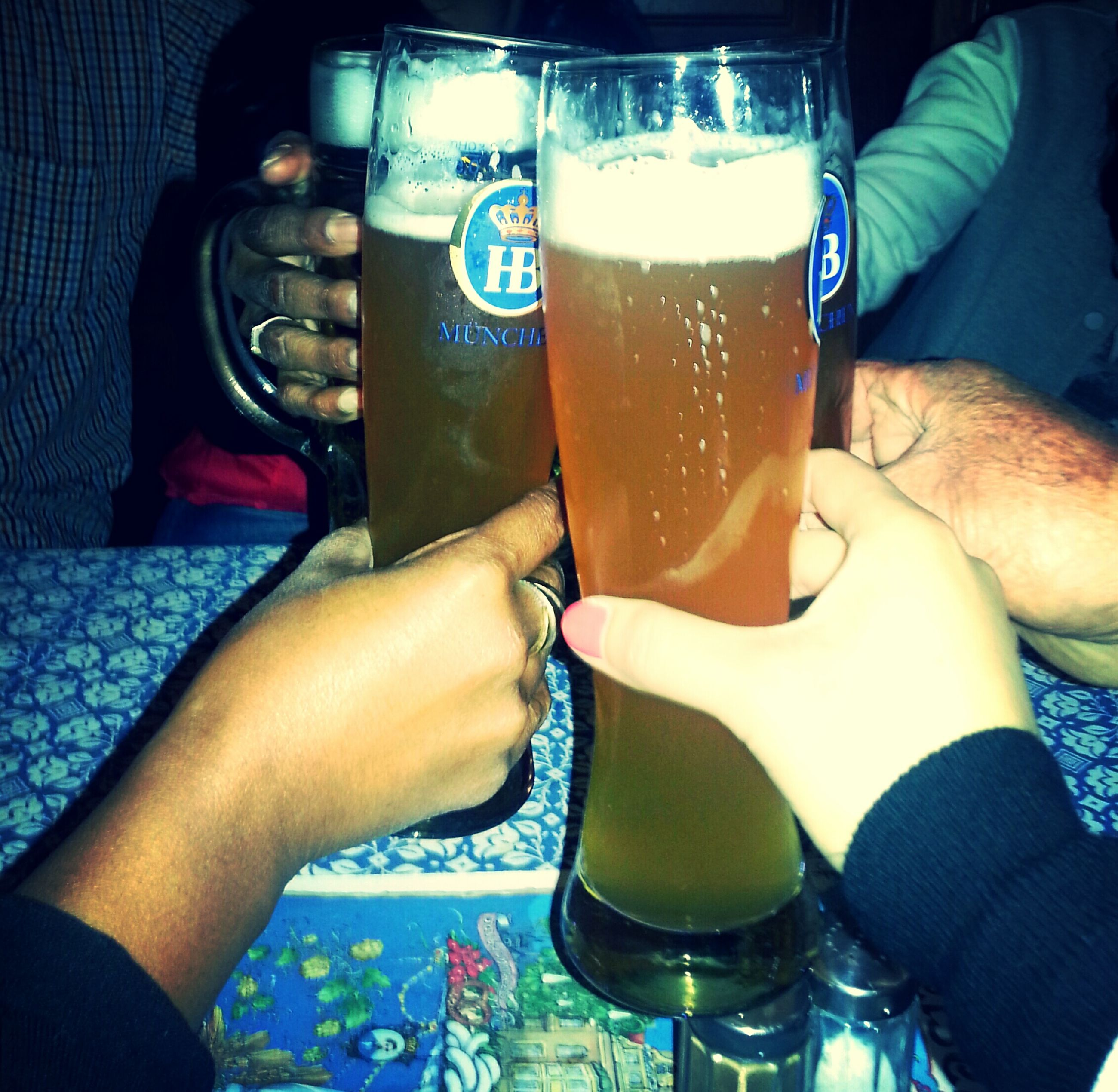 drink, indoors, lifestyles, food and drink, men, refreshment, leisure activity, person, holding, table, sitting, drinking glass, togetherness, friendship, part of