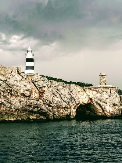 Sea Lighthouse Outdoors Summer Water Architecture Cloud - Sky Nature Sky Beach Harbor No People Day