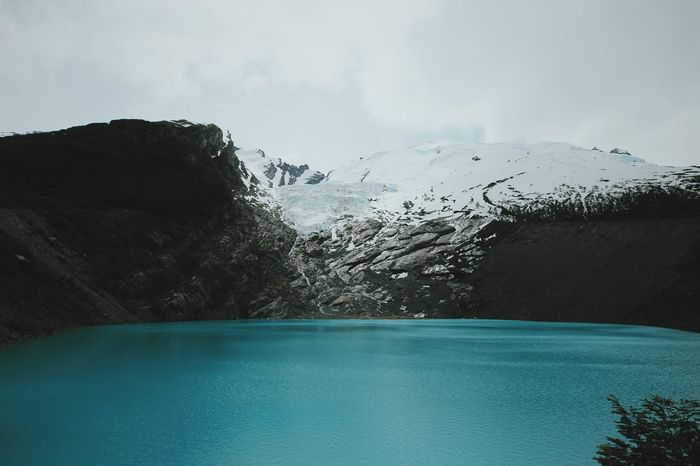 Mountain Scenics - Nature Beauty In Nature Tranquil Scene Water Tranquility Sky Non-urban Scene Day Mountain Range Nature No People Cold Temperature Environment Idyllic Winter Lake Snow Snowcapped Mountain Outdoors Swimming Pool Turquoise Colored Mountain Peak