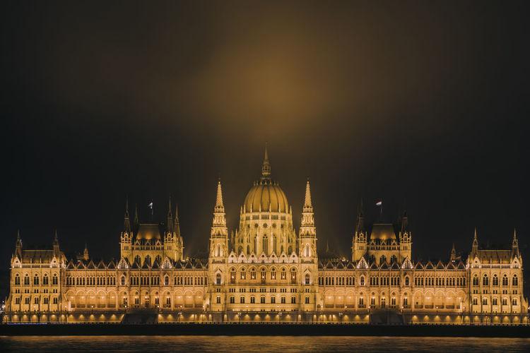 Illuminated hungarian parliament  against sky at night