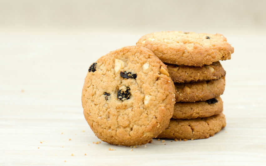 Close-up of cookies stacked on table