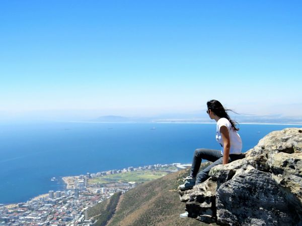 Sea Full Length Blue Rock - Object Outdoors One Person One Woman Only Day Market Bestsellers 2017Nature Rock Climbing Rear View Focus On Foreground EyeEmNewHere EyeEm Best Shots Photography Beauty In Nature Women Around The World Nature Sky Traveling The World Live For The Story Lion Lions Head Lions Head, Cape Town The Great Outdoors - 2017 EyeEm Awards Place Of Heart