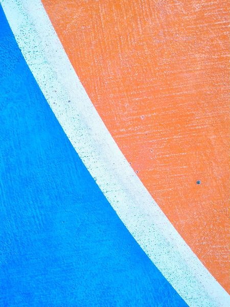 Blue Backgrounds No People Red Textured  Day Full Frame Outdoors Close-up Architecture Football Stadium Footsal Textured  Orange Color
