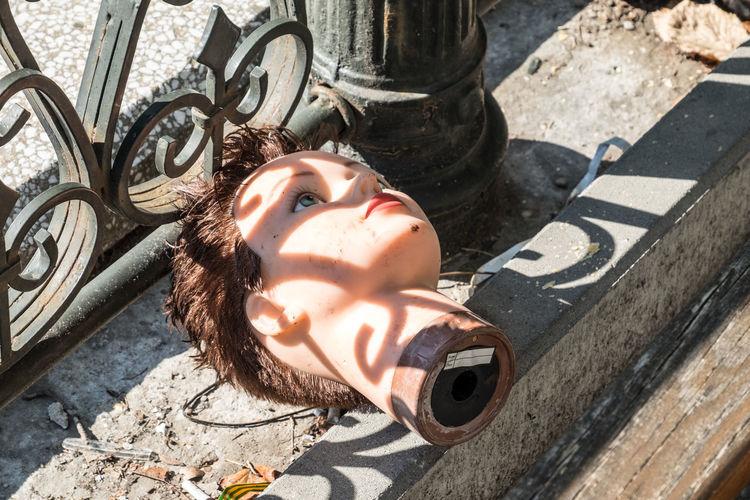 Broken mannequin outdoors