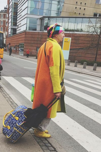 The Street Photographer - 2017 EyeEm Awards Full Length Reflective Clothing Rear View One Person Jacket Day Yellow Built Structure Older Woman Happy Colors Headwear Architecture Standing Outdoors Building Exterior One Man Only City Helmet Real People Protective Workwear Break The Mold