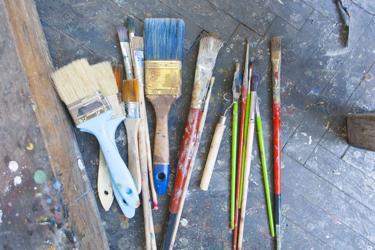 many paint brushes on the floor Paint Brushes Many Floor Ground Used Draw Paintbrush Art Tool Messy Set Wooden Color Vintage Drawing Palette Colorful Rustic Oil Artist Mess Paintings Grunge Painter Hobby Brush Retro Work Equipment Concept Dirty Multicolor Background Accessories Artistic Group Smears Blót Mixing Worn Design Fabric Tools Stain Dye Bristle Canvas Creative Spot