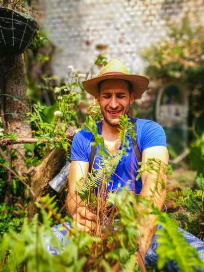 Man picking plants in garden