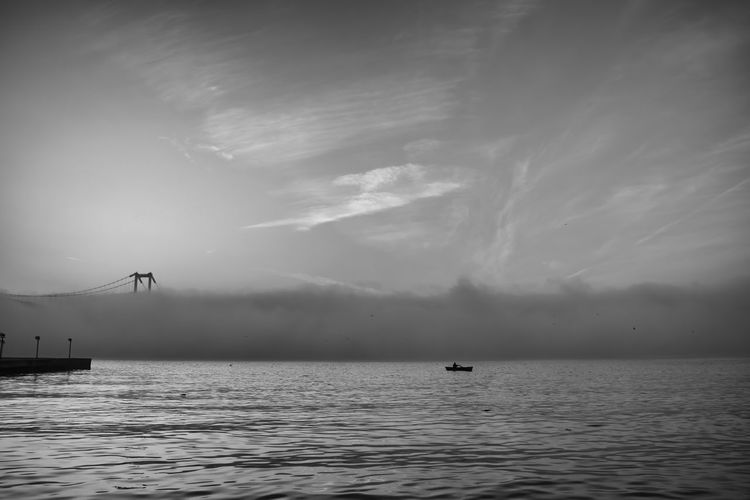 Scenic view of sea against sky and fog
