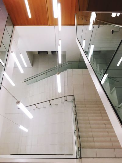 Architecture Indoors  Staircase Built Structure Steps And Staircases No People Railing Ceiling Building Lighting Equipment Wall - Building Feature Fluorescent Light Industry
