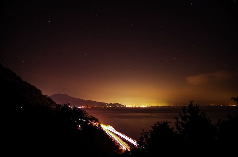 Scenic View Of Lake Against Mountains At Night