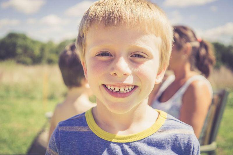 Portrait of smiling boy on field